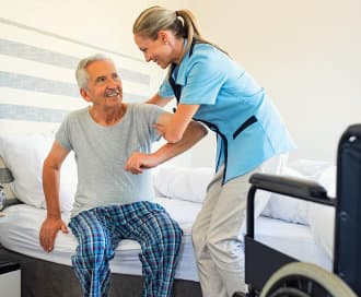 caregiver assisting a senior man
