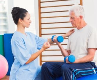 senior man exercising with his therapist