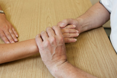 hand occupational male therapist doing massage on female hand